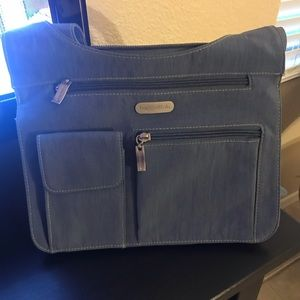 Baggallini blue w/ lime green inside. Barely used